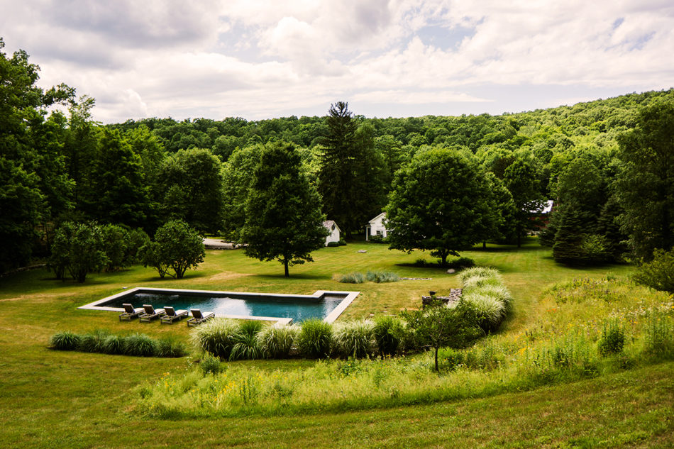 Close to Hudson, country residence: rolling lawns, gardens, pool, fields and forest.