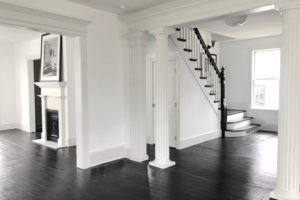 back and white, dining room, stairs, staircase, stairway, hardwood floors, black floors, columns, american foursquare, nicole vidor, real estate, realtor, for sale, home, house, hudson, new york, ny