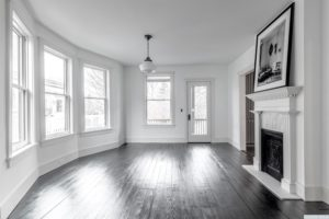 living room, back and white, bay window, hardwood floors, black floors, entrance, american foursquare, nicole vidor, real estate, realtor, for sale, home, house, hudson, new york, ny