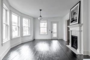 living room, back and white, bay window, hardwood floors, black floors, entrance, american foursquare, nicole vidor, real estate, realtor, for sale, home, house, hudson, new york, ny