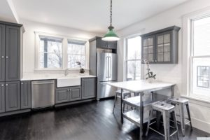 kitchen, stainless steel, large windows, farmhouse sink, subway tile, back and white, hardwood floors, black floors, american foursquare, nicole vidor, real estate, realtor, for sale, home, house, hudson, new york, ny