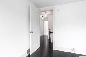 bedroom, back and white, hardwood floors, black floors, hallway, american foursquare, nicole vidor, real estate, realtor, for sale, home, house, hudson, new york, ny