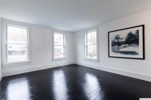 bedroom, back and white, hardwood floors, black floors, large windows, american foursquare, nicole vidor, real estate, realtor, for sale, home, house, hudson, new york, ny