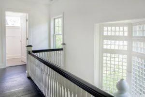Renovated home, upstairs hallway, multi paned window, dark wood floors, bathroom, catskill, new york, nicole vidor, real estate, realtor
