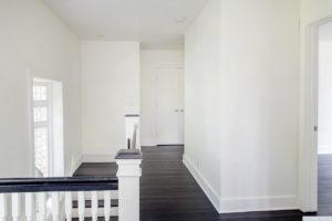Renovated home, upstairs hallway, multi paned window, dark wood floors, bedrooms, catskill, new york, nicole vidor, real estate, realtor