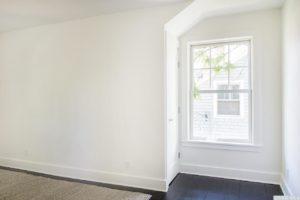 Renovated home, upstairs hallway, multi paned window, dark wood floors, catskill, new york, nicole vidor, real estate, realtor
