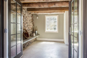 Milkweed Barn, Converted Barn, french doors, exposed beams, exposed stone foundation wall, nicole vidor, real estate, realtor
