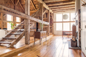 Milkweed Barn, Converted Barn, dining room, living room, open floor plan, stairs, double windows, exposed beams, nicole vidor, real estate, realtor