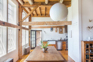 Milkweed Barn, Converted Barn, dining room, kitchen, double windows, exposed beams, nicole vidor, real estate, realtor