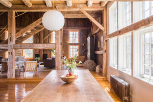 Milkweed Barn, Converted Barn, dining room, open floor plan, stairs, wood, exposed beams, wood floors, double windows, nicole vidor, real estate, realtor