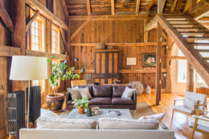 Milkweed Barn, Converted Barn, living room, stairs, wood, exposed beams, wood floors, double windows, nicole vidor, real estate, realtor