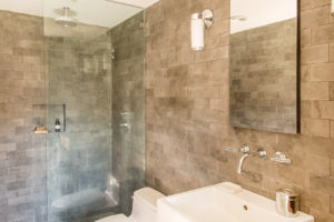 Milkweed Barn, Converted Barn, bathroom, stone tile, walk in shower, nicole vidor, real estate, realtor