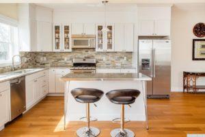 brand new home, kitchen, stainless steel, appliances, island, stone backsplash, wood floors, nicole vidor, real estate, realtor