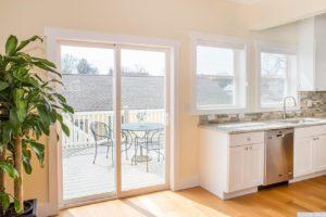 brand new home, kitchen, sliding doors, deck, appliances, stone backsplash, wood floors, nicole vidor, real estate, realtor