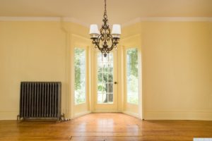 country farmhouse, interior, wood floors, bay doors, living room, for rent, nicole vidor, real estate, realtor