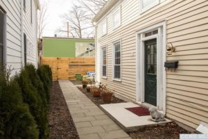hudson ny apartment, side entrance, paved pathway, patio