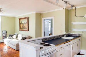hudson ny apartment, kitchen, living room, wood floors, large windows