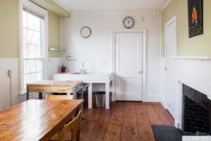 hudson ny aparment, wood floors, decorative fireplace, large windw