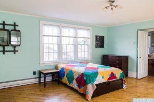 hudson ny apartment, large bedroom, windwos, wood floors